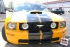 Custom designed, printed, and laminated vinyl racing stripes installed