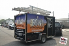 Custom designed, printed, and laminated partial vinyl wrap installed