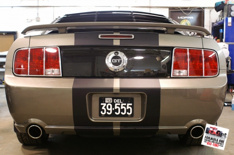 Custom designed and cut-out vinyl racing stripes installed on a Ford Mustang GT